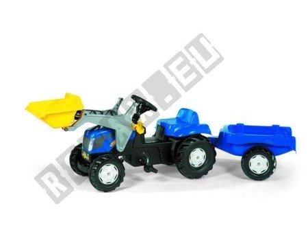 New Holland Traktor mit Eimer und blauem Anhänger